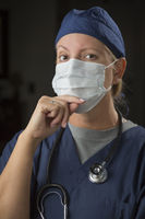 Female Doctor or Nurse Wearing Protective Face Mask