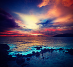 Vintage retro hipster style travel image of ocean sunset with great cloudscape