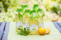 Bottles with lemon balm syrup