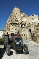 tuff rock cone with tractor, Cappadocia, Turkey