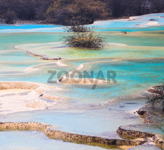 colorful travertine ponds in huanglong