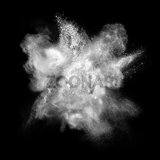 White powder explosion isolated on black