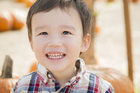Mixed Race Young Boy Having Fun at the Pumpkin Patch