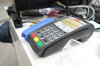 ASTRAKHAN, RUSSIA - JULY 01, 2014: POS terminal of CREDIT EUROPE BANK Ltd. in local store. Credit Europe Bank is owned by Fiba Group, one of the largest financial conglomerates in Turkey.
