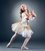 Studio shot of graceful little ballet dancer