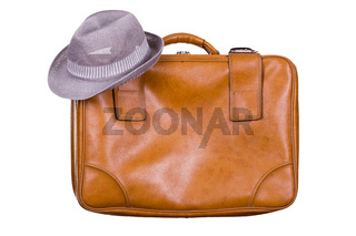 brown suitcase with hat