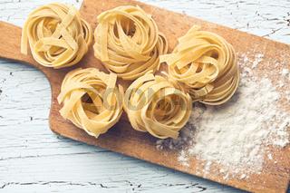 Italian pasta tagliatelle and flour