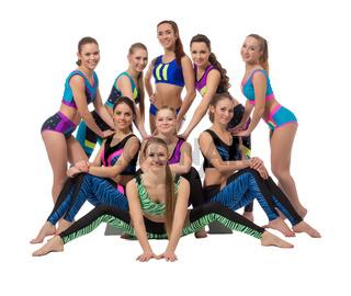 Team of cheerful female athletes posing at camera