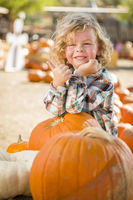 Cute Little Boy Gives Thumbs Up at Pumpkin Patch