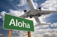 Aloha Green Road Sign and Airplane Above