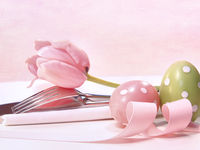 Closeup of utensils and pink tulip