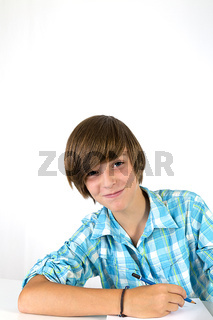 school boy is laughing into the camera, isolated on white