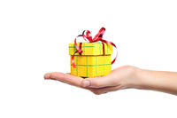 hand holding gift box isolated