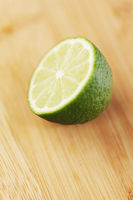 Cut lime on a wooden board
