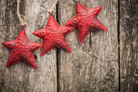 Redd Christmas tree decorations on grunge wood