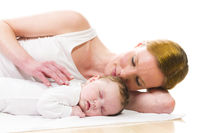 Newborn baby sleeping with mother