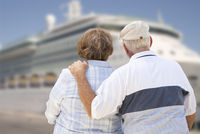 Senior Couple On Shore Looking at Cruise Ship
