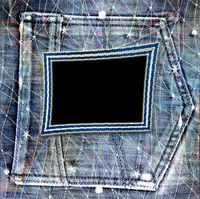 Old vintage frame on shabby jeans background