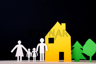 A Family in Front of their House with Trees beside