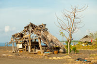 Ruined hut on the beach. Indonesia, Bali