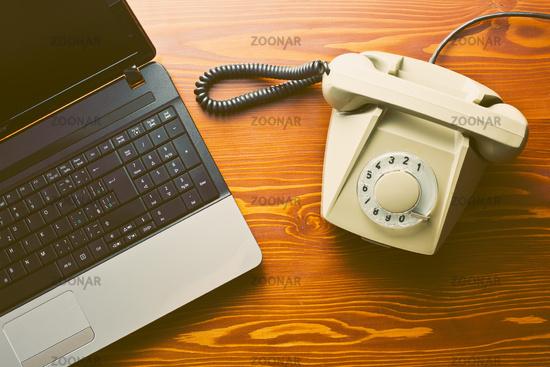 retro phone and modern laptop