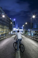 Men on a Bicycle on Empty Way