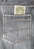 One dollar bill sticking in the back pocket of denim  black jeans