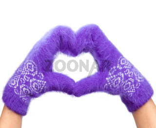 Hands in fluffy lilac mittens