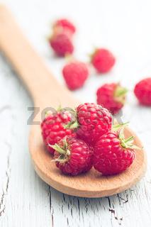 raspberries on wooden spoon