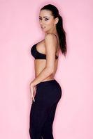 Gorgeous Slim Woman in Black Bra and Leggings