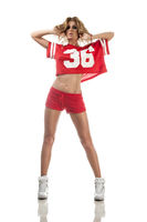 Beautiful young cheerleader in a red uniform