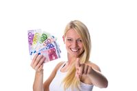 Blonde holds money in hand