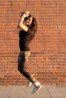 Brunette jump near wall
