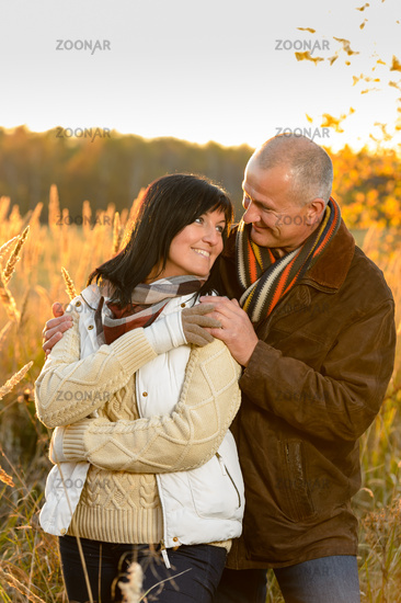 Couple in love hugging in autumn countryside