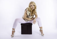 Blonde woman sitting on a stool