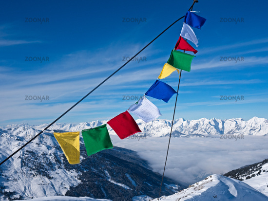 Prayer flag in fron of peaks
