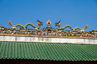 The carving of figurines on roof of Chinese temple