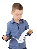 Young boy reading a magazine