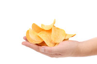 Potato chips on a hand.