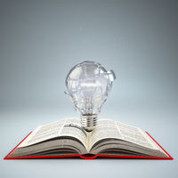 Light bulb on open book. Idea or creativity concept. Education.