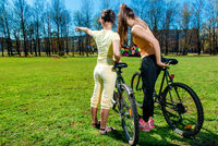 Pretty girls outdoors, summer leisure and cycling concept