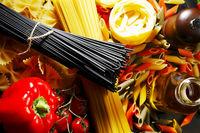 Pasta ingredients on black table