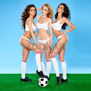 Three beautiful sexy women soccer players