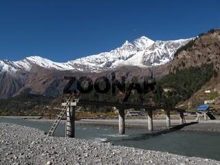 Dhaulagiri and damaged bridge, scenery in Central Nepal