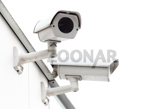 Security camera mounted on wall.
