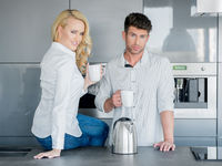 Couple enjoying a pot of freshly brewed coffee