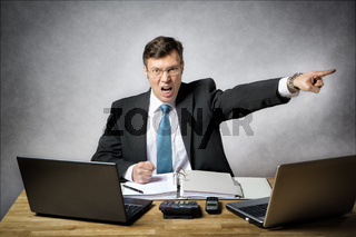 Angry business man in office