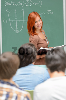 Student girl standing front of chalkboard math