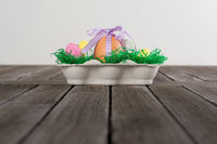 Easter Nest with eggs on a wooden table.