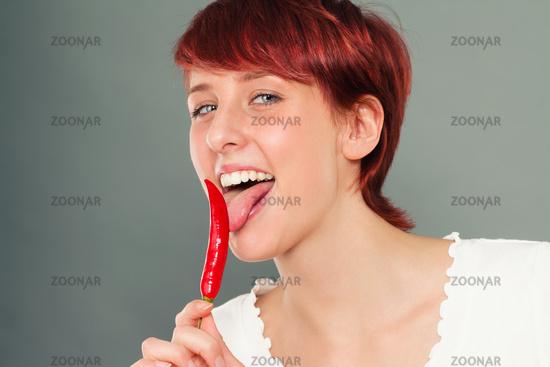 happy woman licking chili